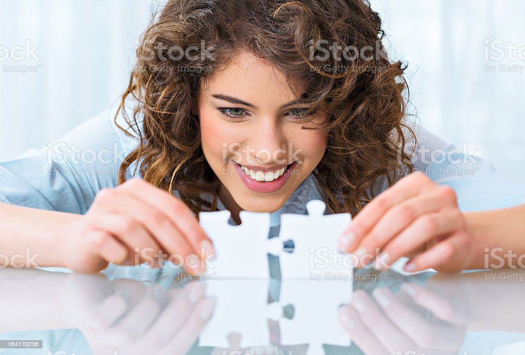 Beautiful businesswoman with puzzle stock photo