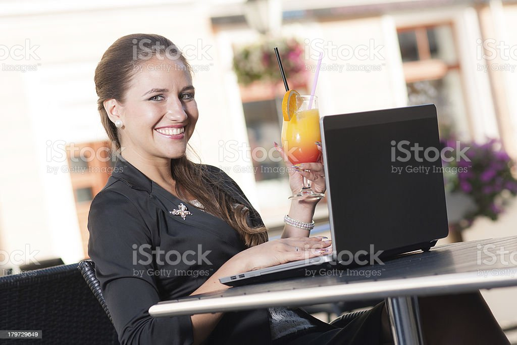 Beautiful businesswoman working in cafe royalty-free stock photo