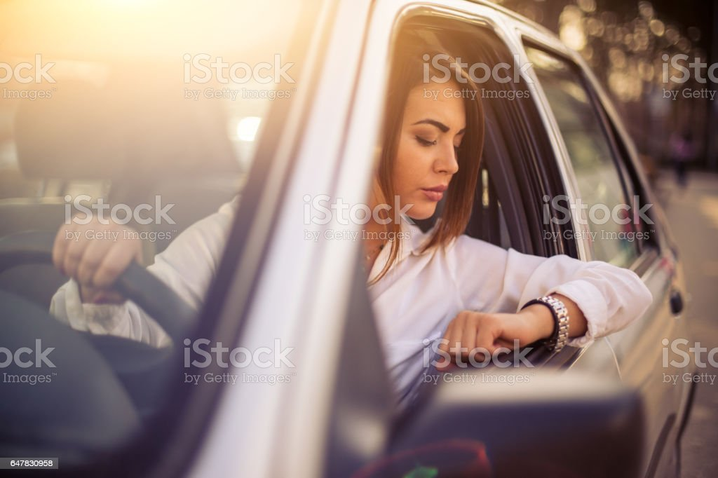 Beautiful businesswomen checking the time stock photo