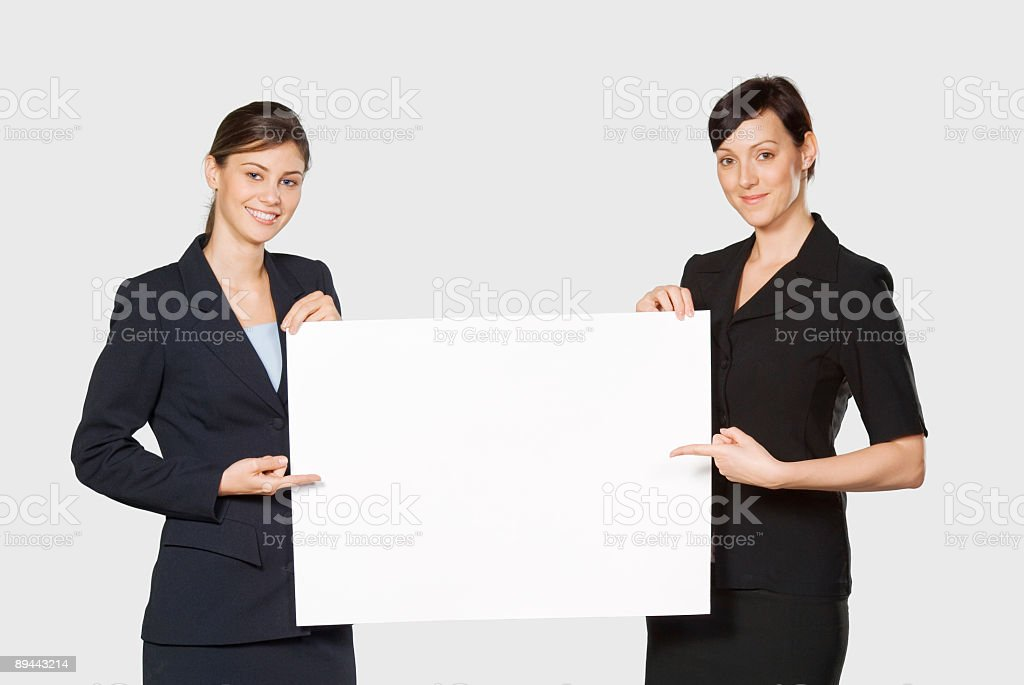 Beautiful businesswomen with blank paper royalty-free stock photo
