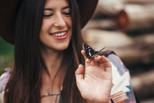 Beautiful butterfly on girl hand stylish hipsterhappy woman in hat picture id1049836108?b=1&k=6&m=1049836108&s=612x612&w=0&h=etvjih5cl ngd1ebfdsoqxnqfah3pzsmyxyhwt xzko=