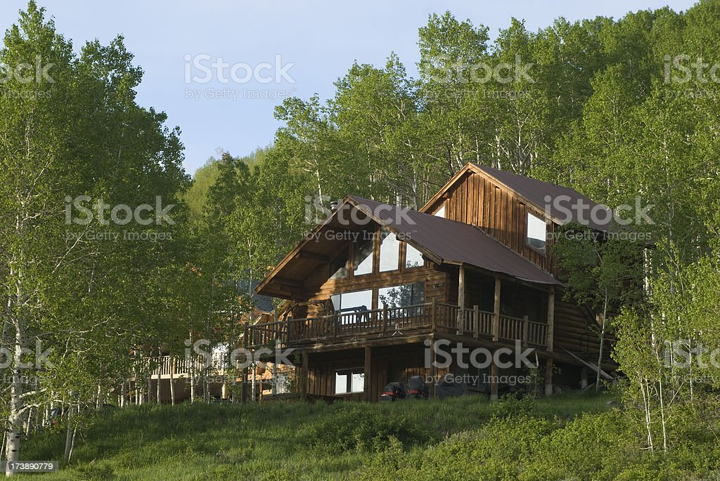 A beautiful cabin in the woods stock photo