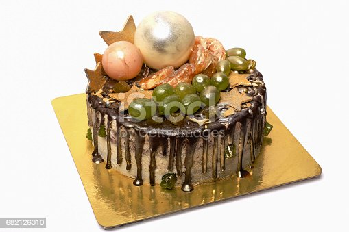 480972628 istock photo A beautiful cake decorated with grapes chocolate, with decor elements and gold sparkles 682126010