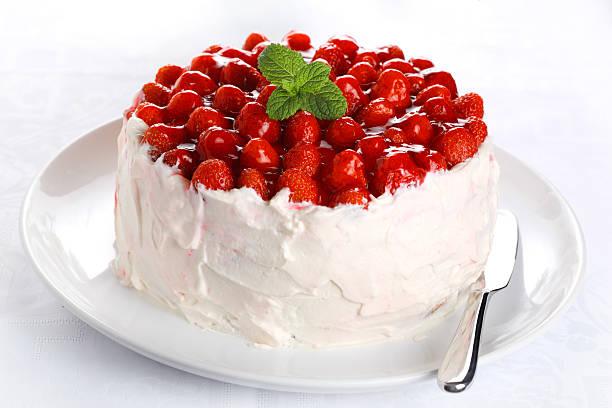 beautiful cake with strawberries and cream stock photo