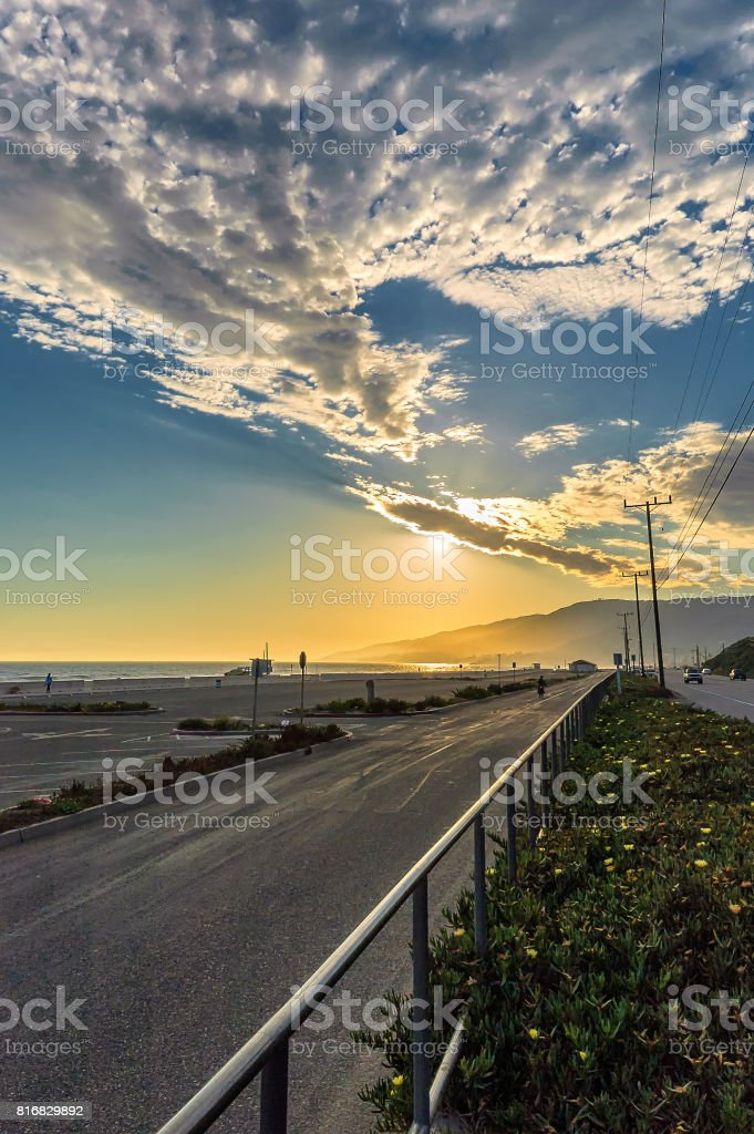 Beautiful California beach sunset seen from Pacific Coast Highway stock photo