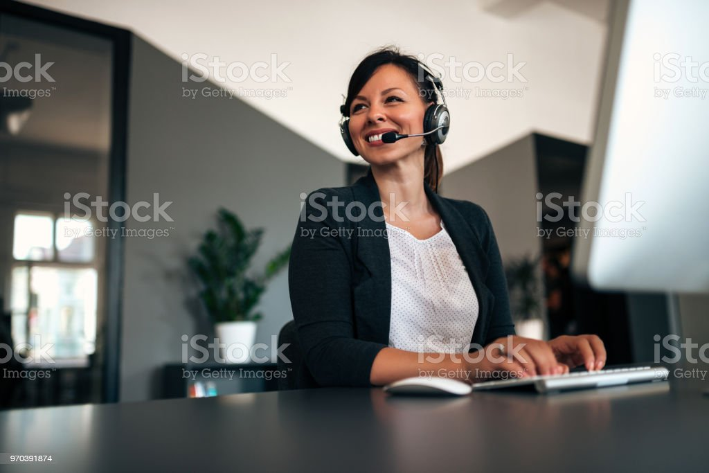 Beautiful call center consultant in headphones. stock photo