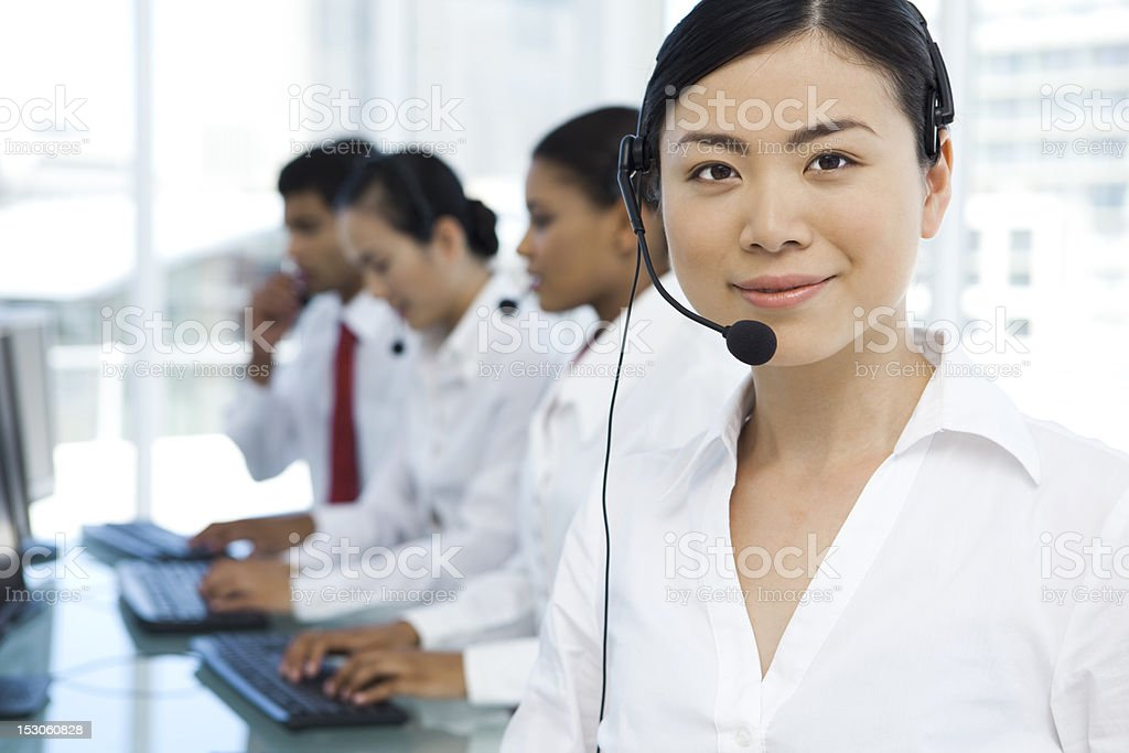 Beautiful call center operator at workplace stock photo