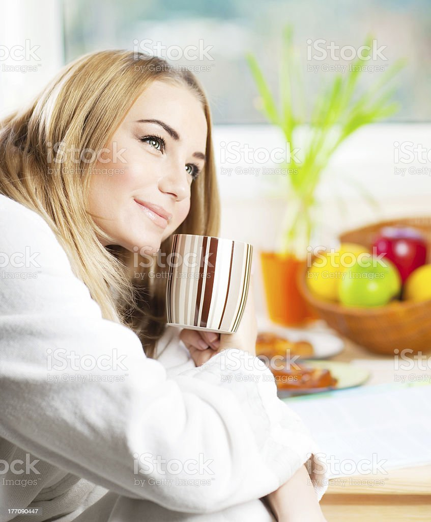 Beautiful calm young woman having morning coffee royalty-free stock photo