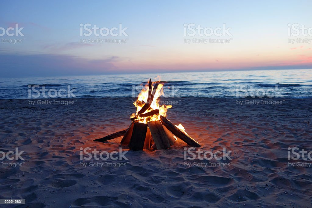 Beautiful campfire by the lake stock photo