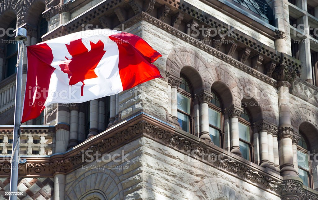 Beautiful Canada flag is waving stock photo