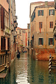 View of canal and typical buildings in Venice - Italy.