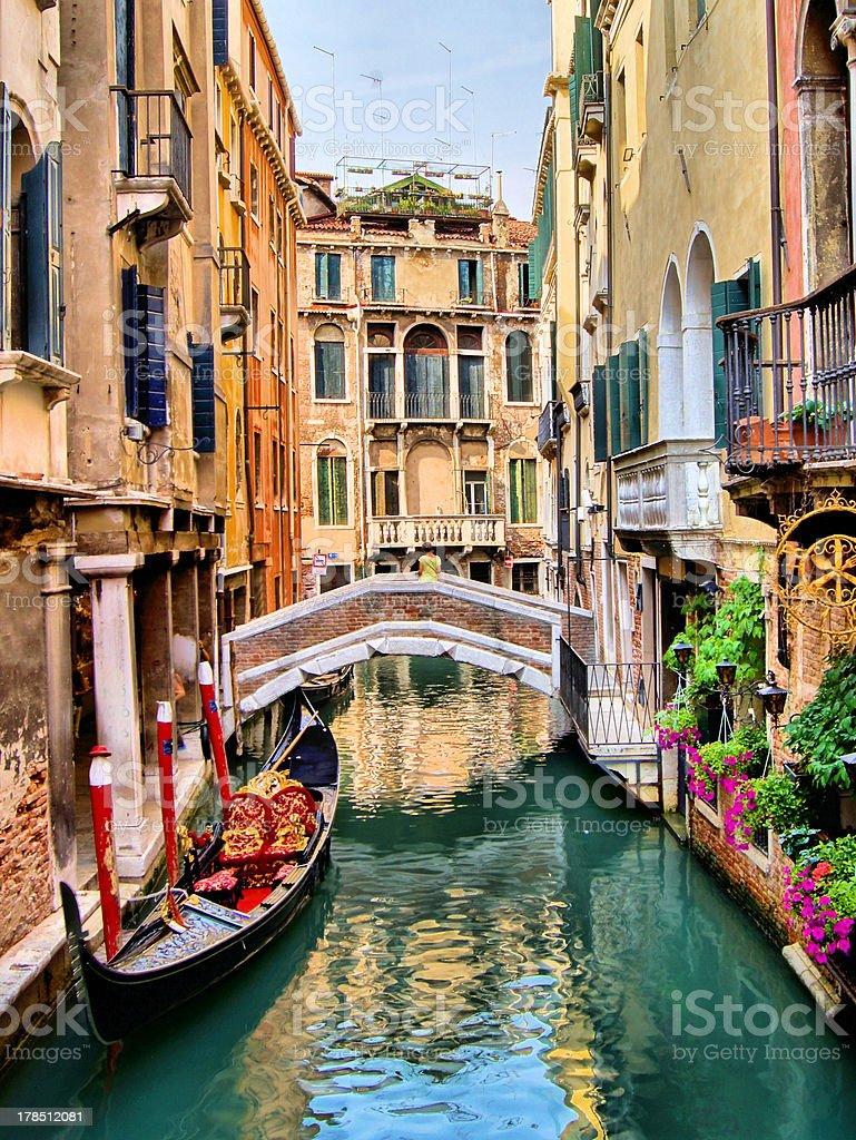 Beautiful canal scene with gondola, Venice, Italy stock photo