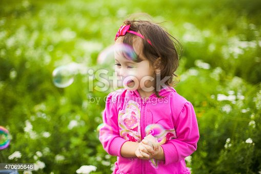 507271044istockphoto beautiful carefree girl playing outdoors in field 470695646