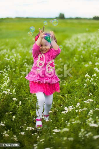 507271044istockphoto beautiful carefree girl playing outdoors in field 470698384