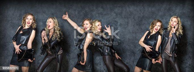 istock Beautiful carefree girls posing in the Studio 935832370