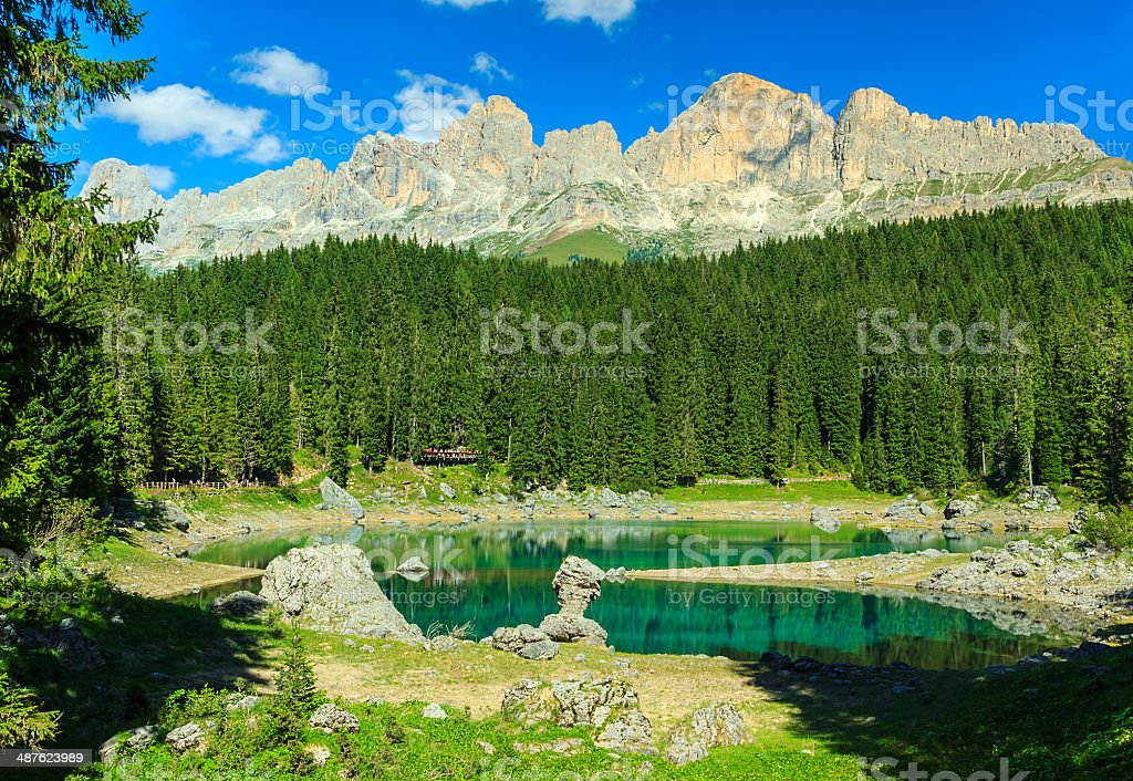 Beautiful Carezza lake,(Lago di Carezza) in the forest,Dolomites,Italy stock photo