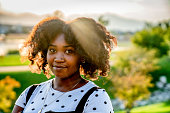 istock Beautiful Caribbean African Woman Smiling at the Camera Backlit by Beautiful Sunset Lighting with Lens Flare 1270476383
