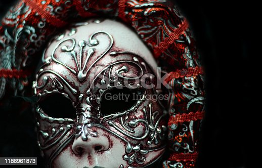 istock beautiful carnival mask on a black background 1186961873