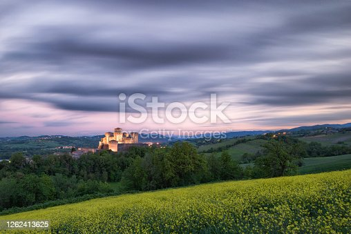 Beautiful castle photographed at the last sunset lights a little cloudy