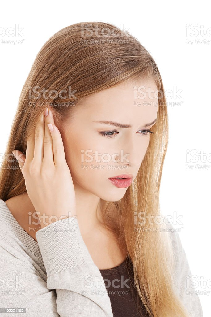 A beautiful casual female touching her ear stock photo