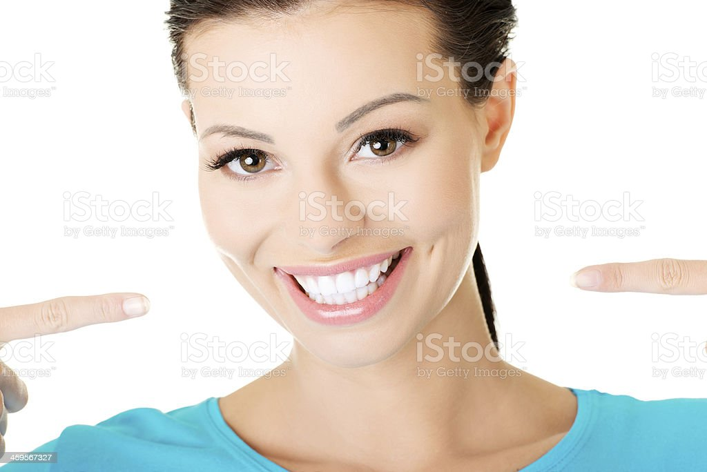 beautiful casual woman showing her perfect white teeth. stock photo