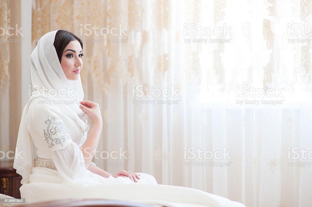 beautiful caucasian bride in traditional dress stock photo