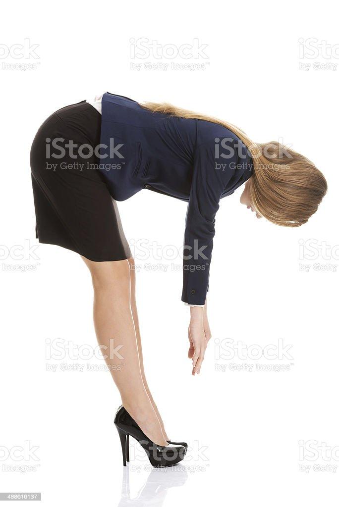 Beautiful caucasian business woman bending down. royalty-free stock photo