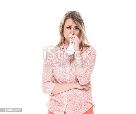 Beautiful caucasian female wearing orange clothes - crying
