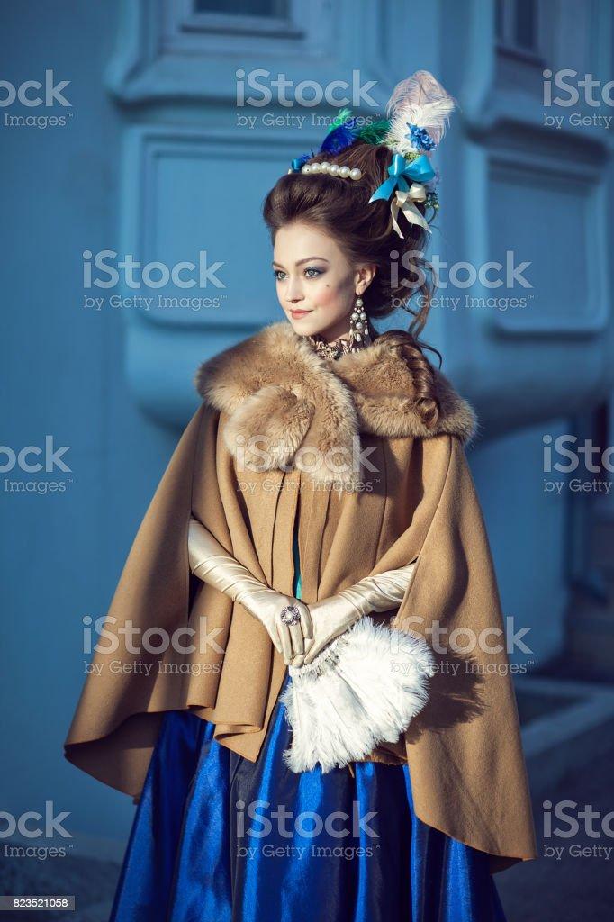 Beautiful caucasian girl dressed in rococo style stock photo