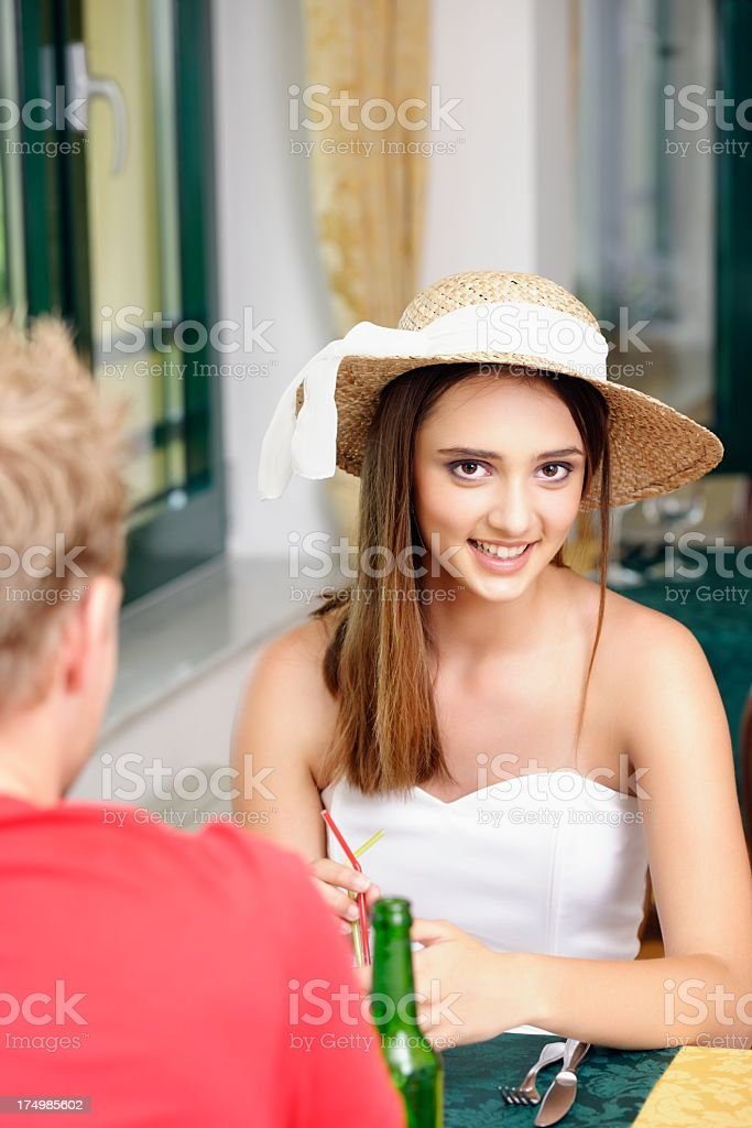 Beautiful Caucasian Girl Having A Drink With Friend/ Partner royalty-free stock photo