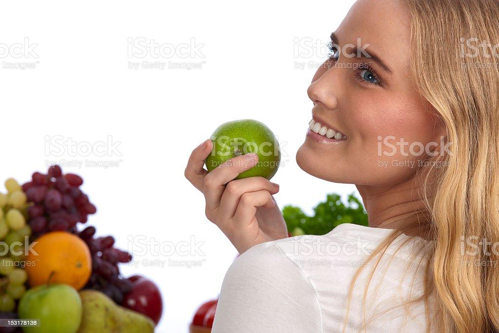 Beautiful caucasian woman eating green apple royalty-free stock photo