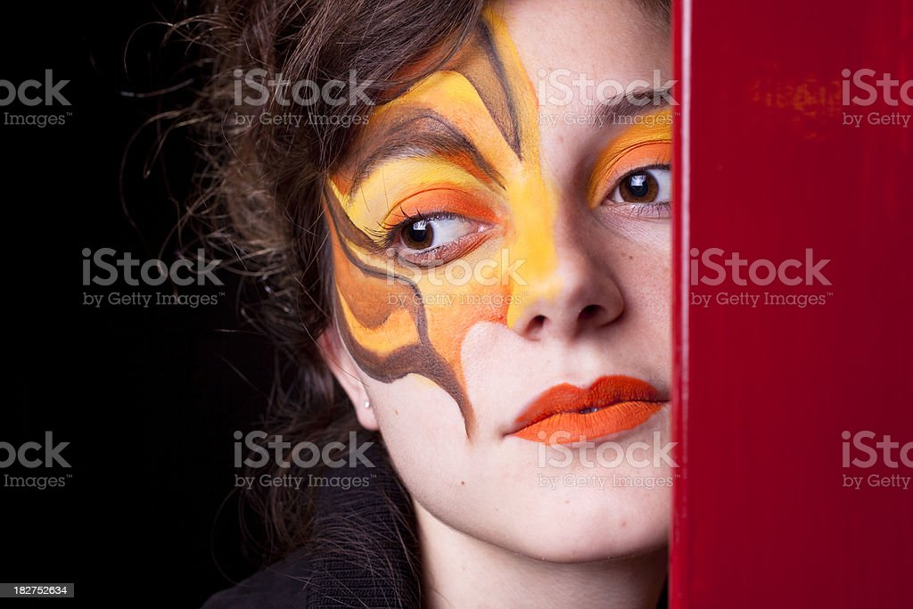 Beautiful caucasian young lady with dramatic face paint. royalty-free stock photo