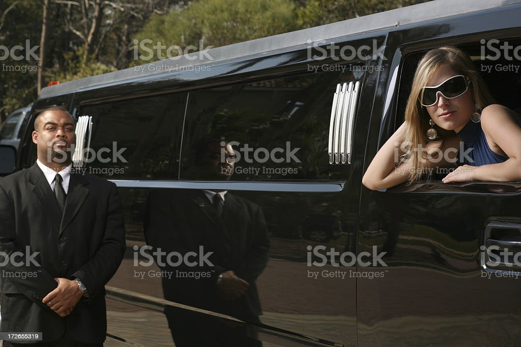 Beautiful Celebrity young woman in a Limo royalty-free stock photo