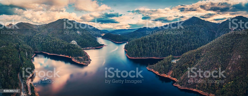 Beautiful Cethana lake and surrounding forest aerial panorama stock photo