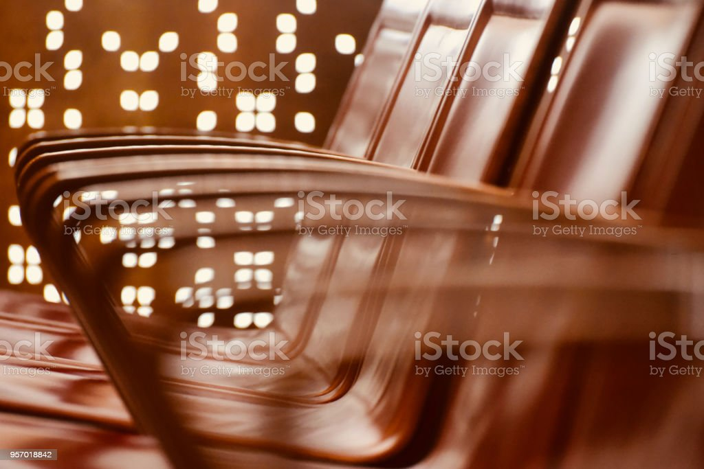Beautiful chairs handlebar illuminated lights blurred background photo stock photo