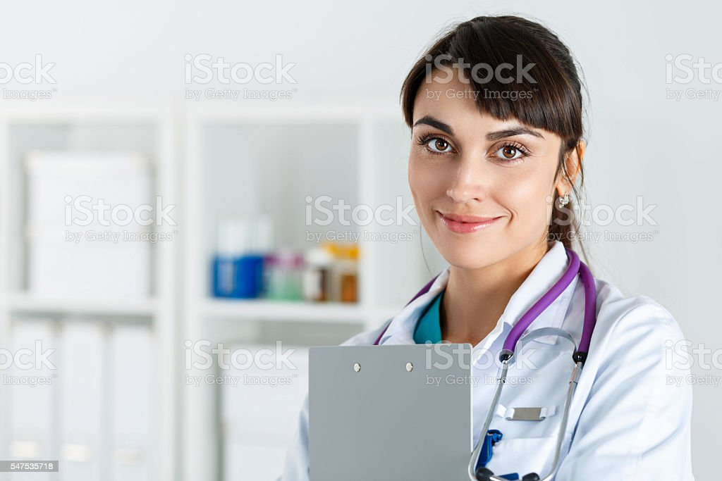 Beautiful charming friendly smiling female medicine doctor stock photo