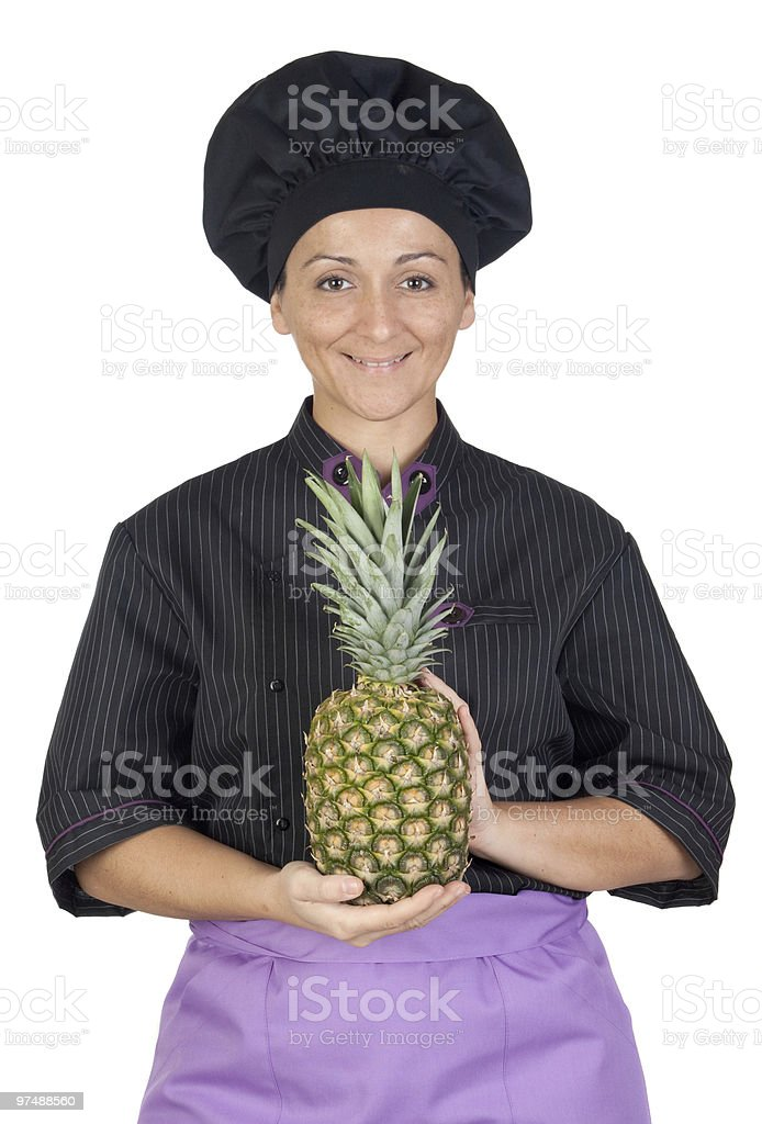 Beautiful chef girl with pinneapple royalty-free stock photo