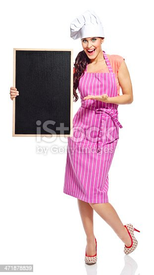 istock Beautiful chef with blackboard 471878839