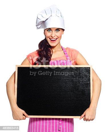 istock Beautiful chef with blackboard 483863415