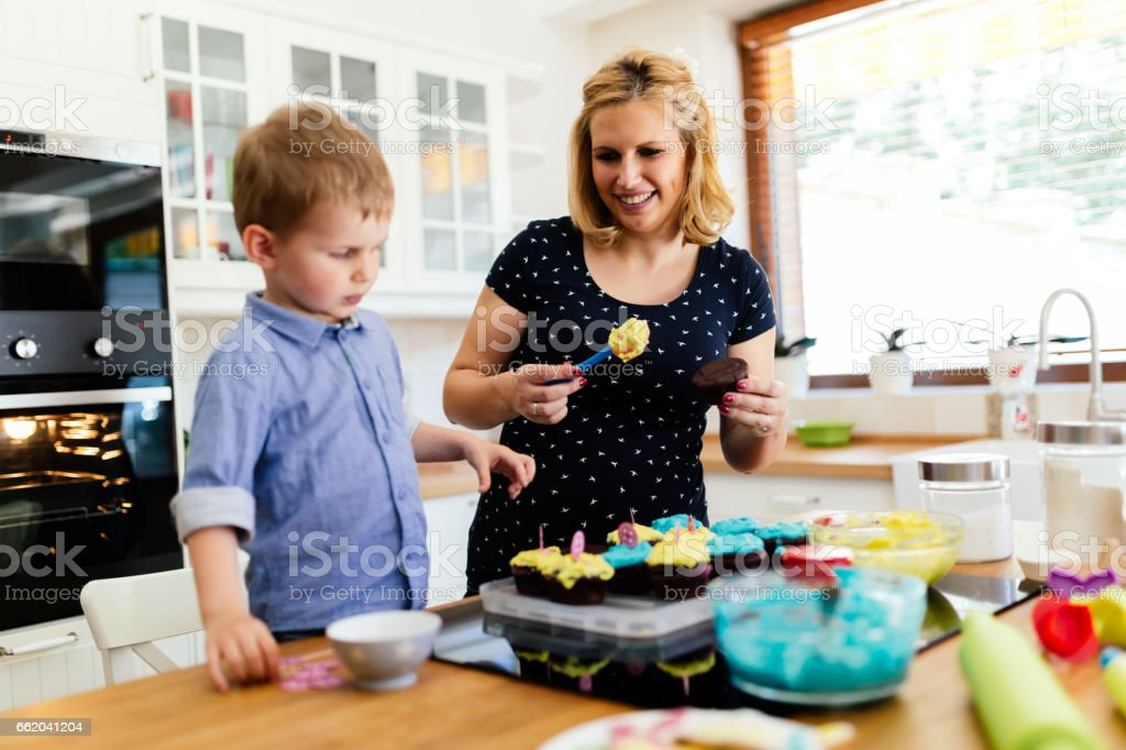 Beautiful child and mother baking in kitchen with love royalty-free stock photo