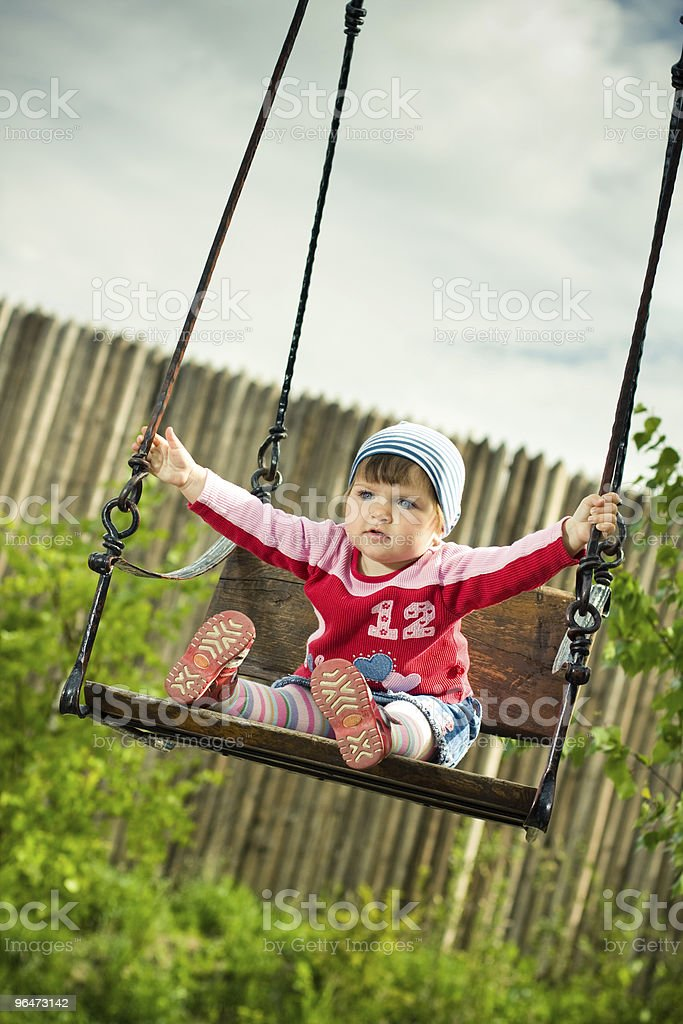 beautiful child on the swings royalty-free stock photo