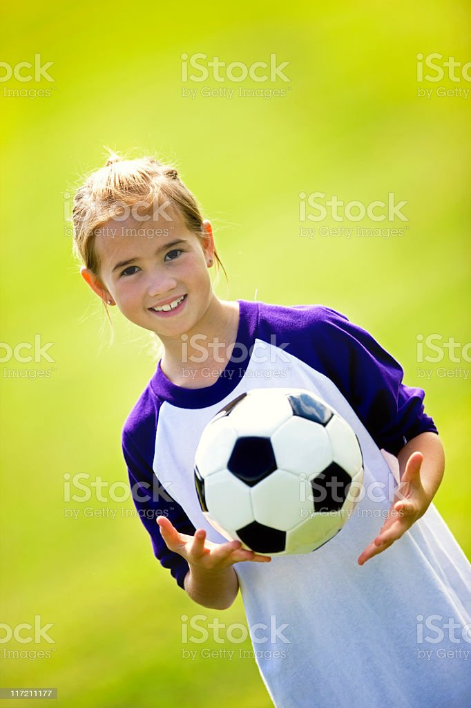 Beautiful Child Tossing A Soccer Ball royalty-free stock photo