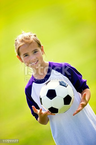 istock Beautiful Child Tossing A Soccer Ball 117211177