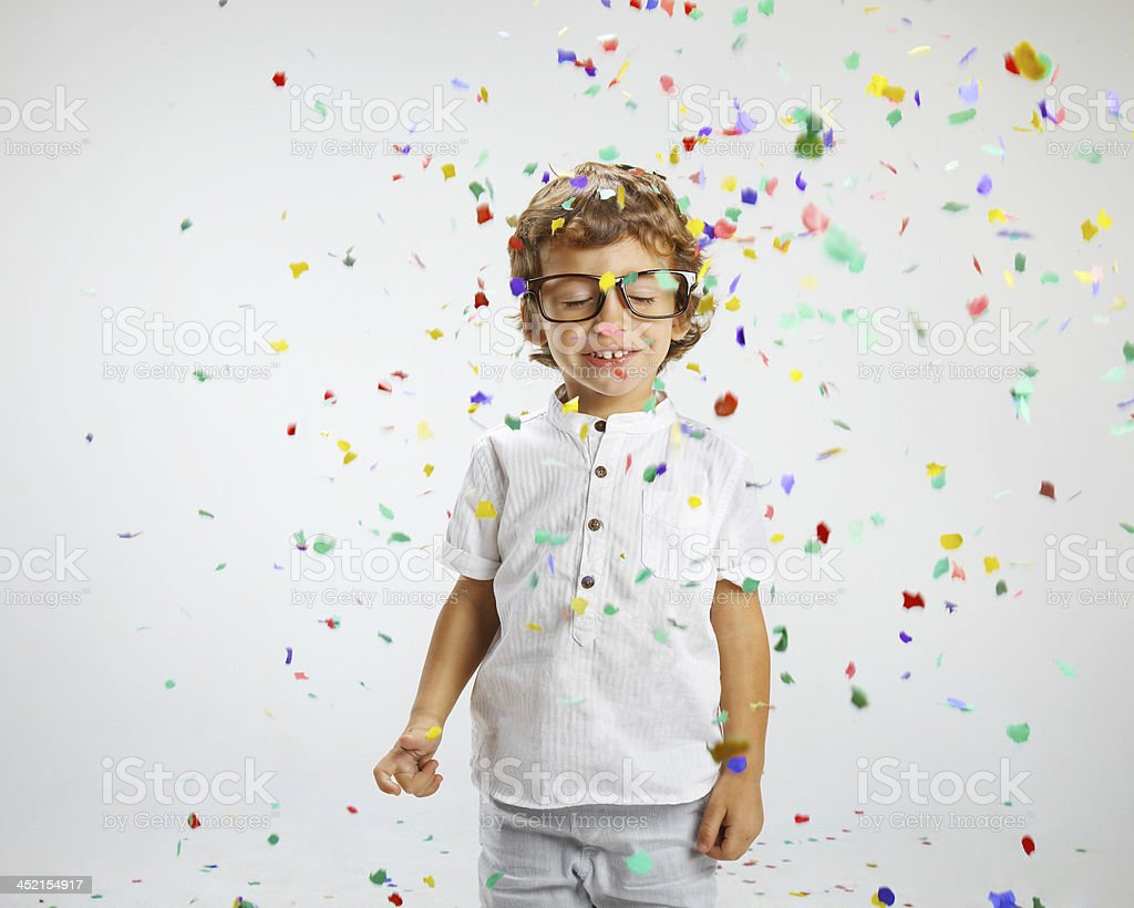 beautiful child with rimmed glasses and confetti stock photo