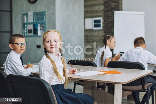 istock Beautiful children are students together in a classroom at the school receive education happy 1011293324