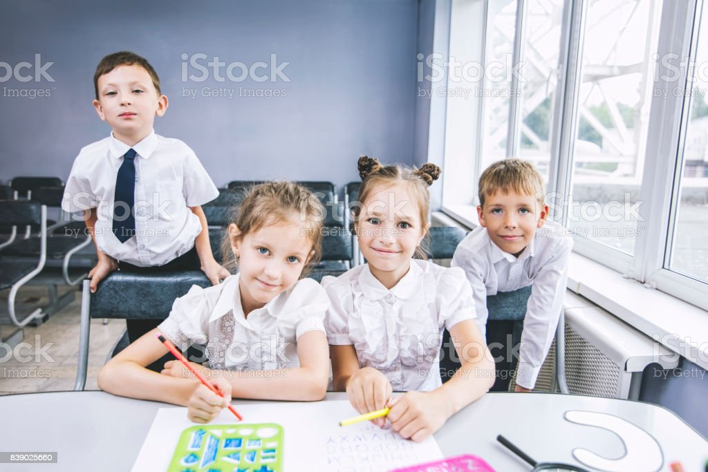 Beautiful children are students together in a classroom at the school receive education happy stock photo