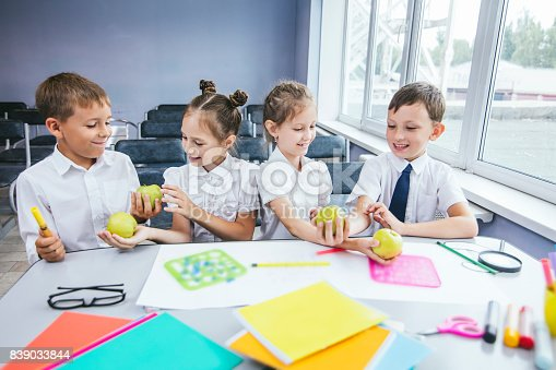 istock Beautiful children are students together in a classroom at the school receive education happy 839033844