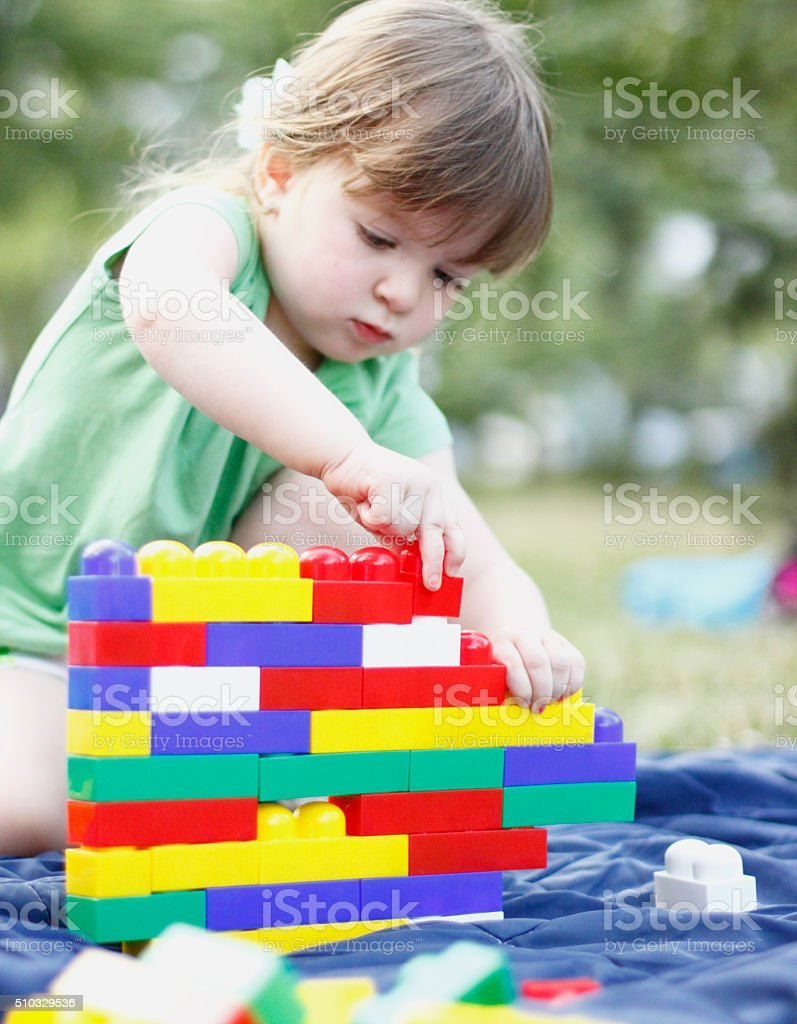 Beautiful children playing with toys stock photo