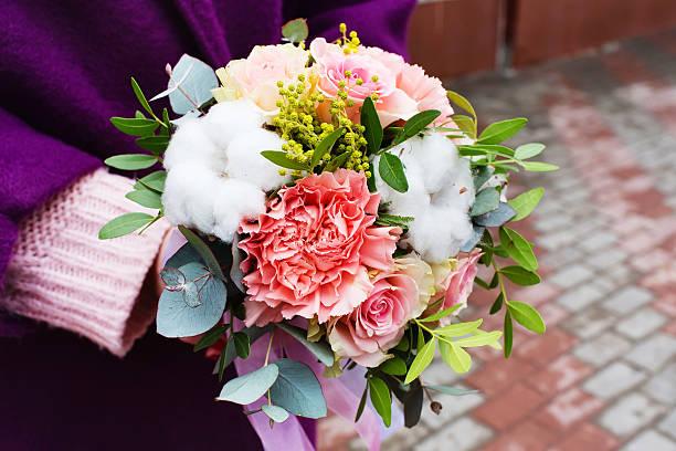 beautiful children's bouquet in female hands - immagini mimosa 8 marzo foto e immagini stock