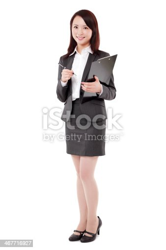 istock Beautiful Chinese Businesswoman Holding Pen and Clipboard Smiling White Background 467716927